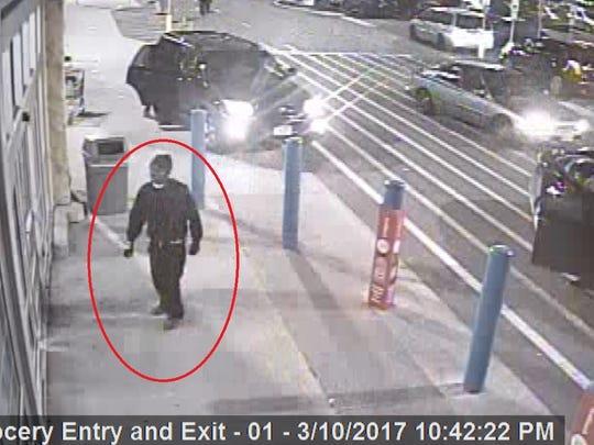 A second suspect entering the Walmart in Teterboro.