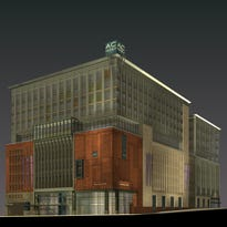 This artist's rendering shows the AC Hotel proposed for the northeastern corner of Broadway and College Street. The prospect of several new hotels downtown has tourism leaders pushing for an increase in the Buncombe County occupancy tax.