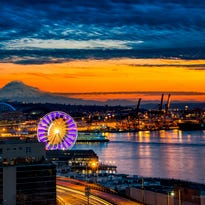 The Seattle Great Wheel shines bright as the sun sets.