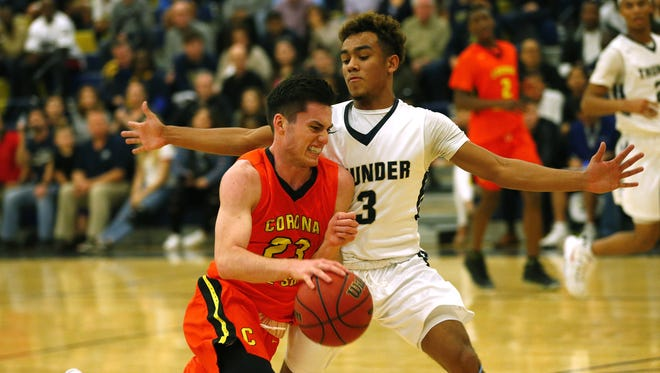 Corona del Sol guard Alex Barcello (23) is defended by Desert Vista guard Alijah Gammage (3) during a game in Phoenix January 17, 2017.