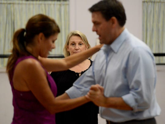 Glory Gymnastics dance instructor Kim Holley supervises the dance steps of University School of Jackson's Head of School Stuart Hirstein and first lady of Union University Susie Oliver as they practice for Jackson's 2016 Dancing with the STARs.
