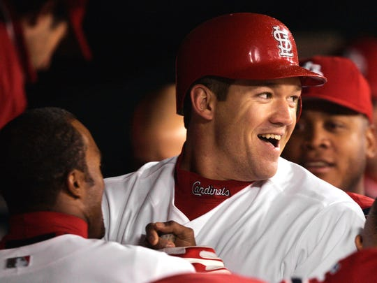 St. Louis Cardinals' Scott Rolen is welcomed to the