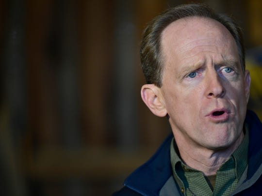 Senator Pat Toomey speaks to a crowd during a campaign