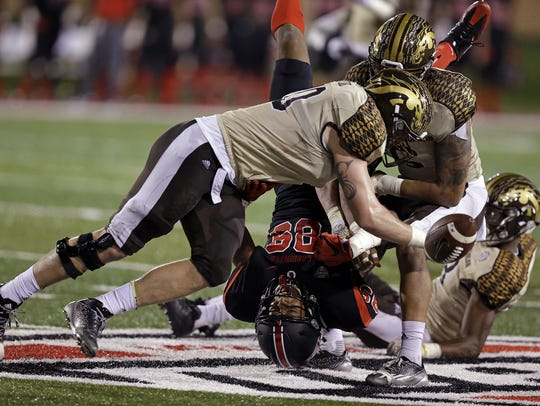 Ball State's Damon Hazelton Jr. fumbles the ball as