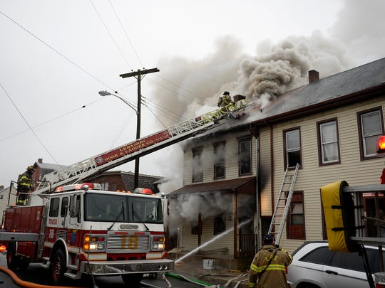 Lebanon City fire crews battle a three-alarm fire at