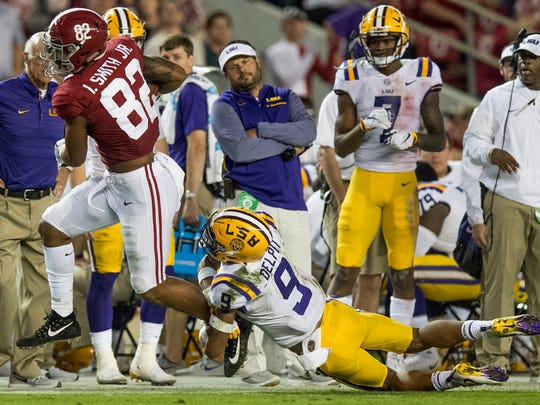 Alabama tight end Irv Smith Jr. (82) is stopped by LSU safety Grant Delpit (9) in second half action at Bryant Denny Stadium in Tuscaloosa, Ala. on Saturday November 4, 2017. (Mickey Welsh / Montgomery Advertiser)