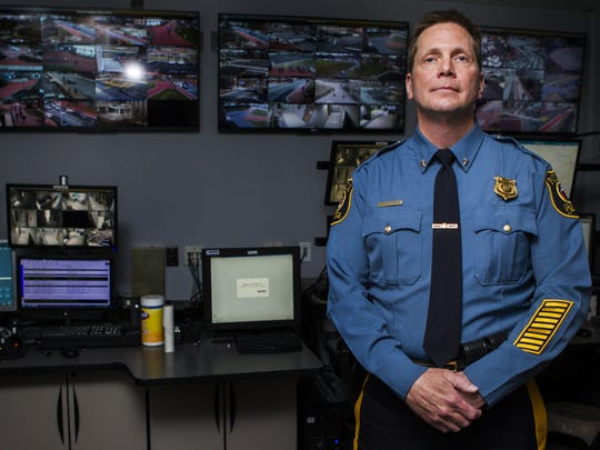 University of Delaware Police Chief Patrick Ogden poses for a portrait in the department's 911 command center on the University of Delaware campus.
