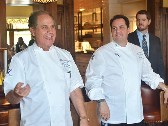 In this file photo, chefs John Folse, left, and Rick Tramonto welcomes guest during a media tour at the then, new Seafood R'evolution at Renaissance at Colony Park in Ridgeland.