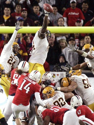 The extra point by Arizona's Alex Zendejas is blocked by Arizona State's James Brooks in the 2010 game in Tucson.