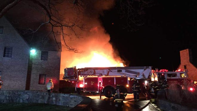 Firefighters battle a blaze at the Ardsley Country Club early Saturday.