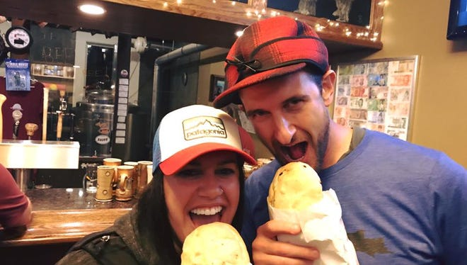 TickPick co-CEO and co-founder Brett Goldberg, right, tries a pasty from Lawry's Pasty Shop with Amber Johnston, an Upper Peninsula resident, on June 20, 2017, at Blackrocks Brewery in Marquette.