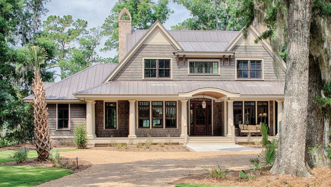 Inspired by Low Country architecture, this graceful home displays a wide porch to welcome guests.