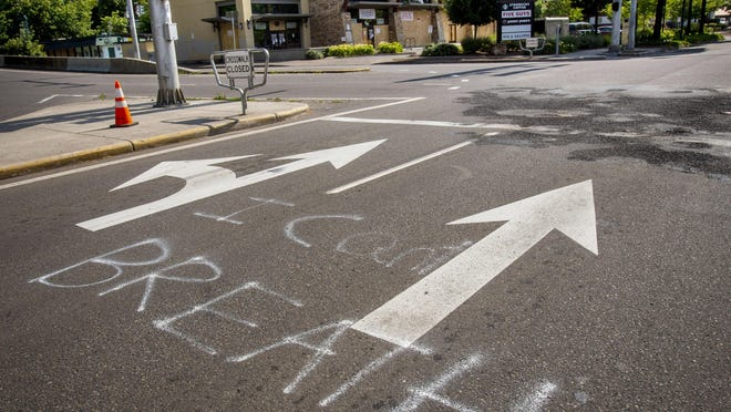 Graffiti remains on West Seventh Avenue near Washington Street where a riot took place May 29 that resulted in property damage and looting at nearby businesses. [Andy Nelson/The Register-Guard] - registerguard.com