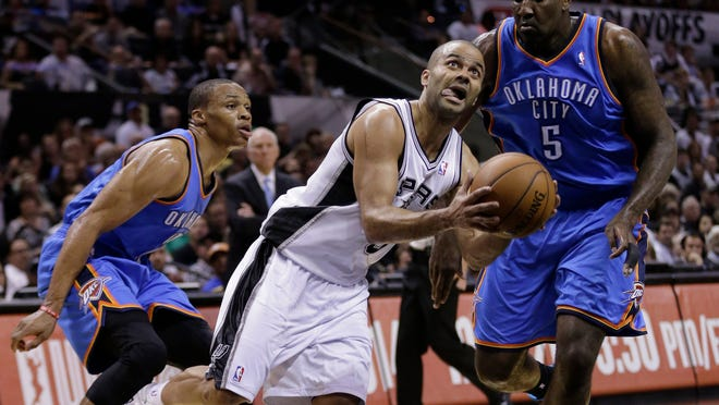 Spurs guard Tony Parker (center) drives past Oklahoma City's Russell Westbrook (left) and Kendrick Perkins during the first half of Game 2 on Wednesday.