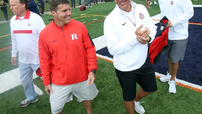 Rutgers Head Coach Chris Ash, l, talks with Ohio State head coach Urban Meyer during the Rutgers Football Tri-state Showcase held on the campus of Fairleigh Dickinson University for high school recruits. June 8, 2016, Florham Park, NJ