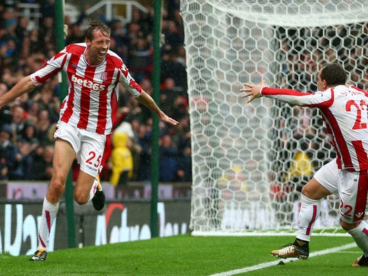 Stoke City's Peter Crouch, left, celebrates scoring his side's second goal with team-mate Xherdan Shaqiri during the English Premier League soccer match between Stoke City and Southampton at the bet365 Stadium, Stoke, England. Saturday, Sept. 30, 2017.  (Dave Thompson/PA via AP)