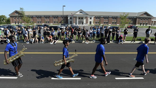 The Nolensville High School band marches past the high school during the homecoming parade Sept. 2, 2016.