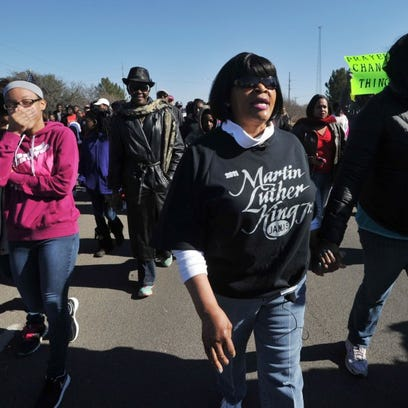 People walk in the annual Martin Luther King Jr. Day