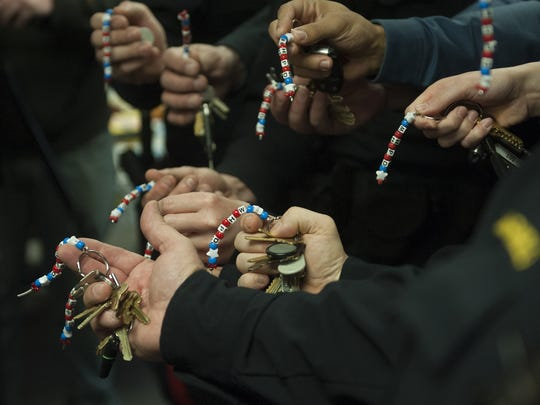 Mount Holly police officers   show their 'hope' keychains