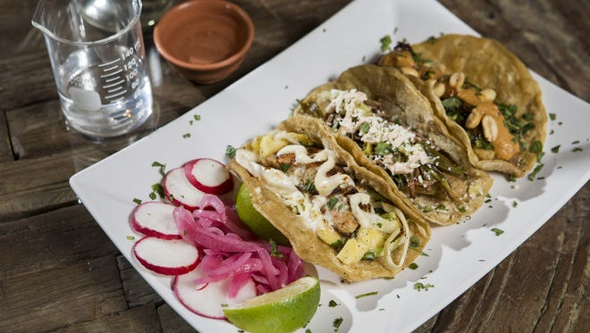 An order of tacos with a beaker of Mezcal Vago at Frida 602 in Covington.