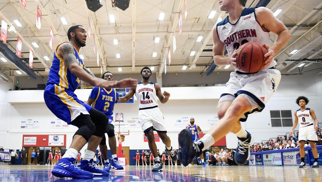 USI's Alex Stein (20) drives to the basket as the University of Southern Indiana men play Fisk University at the PAC Arena Monday, November 20, 2017.