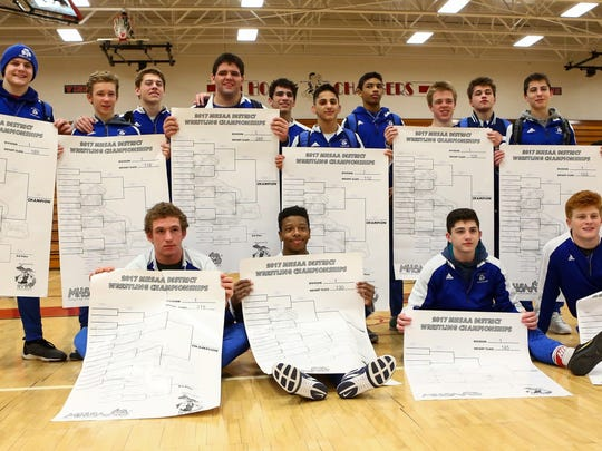 Catholic Central had 10 individual district champions and four other regional qualifiers.