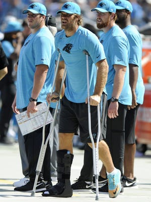 Carolina Panthers tight end Greg Olsen stands on crutches in the second half on Sunday after breaking his foot against the Buffalo Bills.