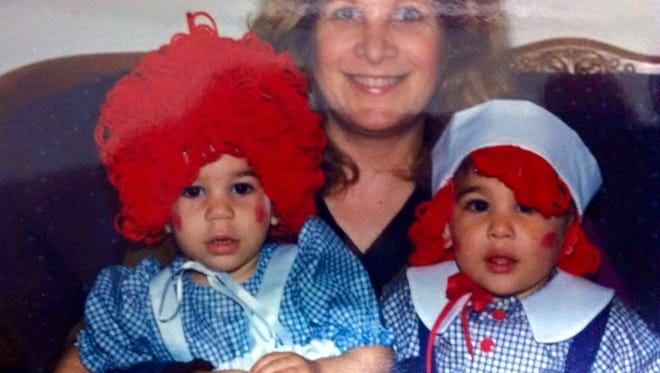 Jane Welsh holds her two children, from left, Livingston Daily reporter Abby Welsh and her brother Dan Welsh. This was their first Halloween. Abby and Dan were both adopted from Romania in 1991.
