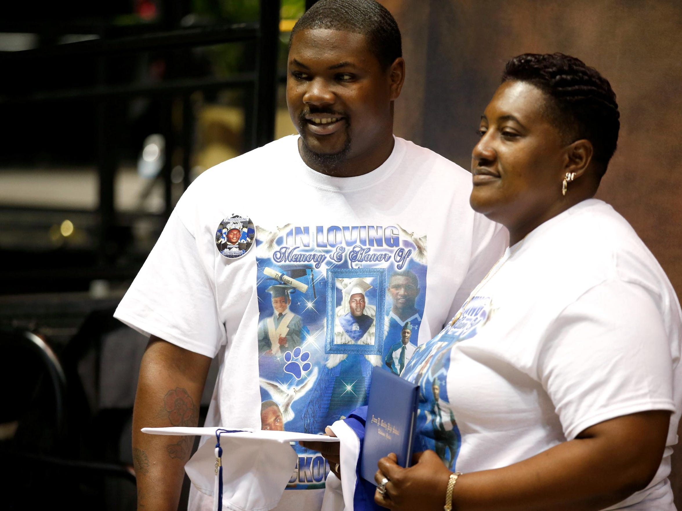 Tori Hannah and her son Gregory Doss Sr. accept a posthumous