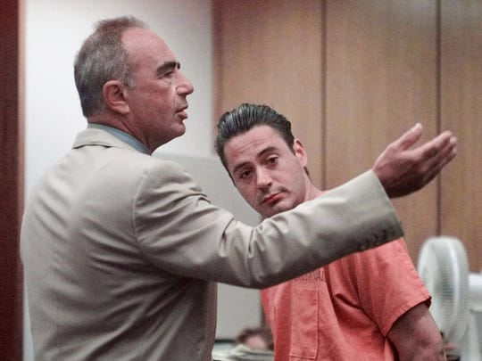 In this Aug. 5, 1999 file photo, defense attorney Robert Shapiro, left, requests that the baliff remove the handcuffs from actor Robert Downey Jr. during his sentencing in Malibu, Calif., Municipal Court.