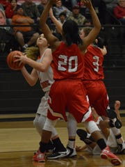 Ira's Madison Peterson (far left) tries to put up a baseline shot while Hermleigh's Aaliyah Sneed (20) and Kelsey Digby (3) try to cut her off in the second quarter of Saturday's game in Ira.  No. 3 Hermleigh held on for a 53-51 win.