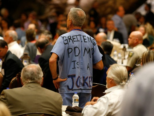 "Gil Mobley, a Springfield doctor and political activist, attended the Missouri Opioid Crisis Summit at the White River Conference Center wearing scrubs with a message prominently written across his back: ""Greitens' PDMP is a joke."""