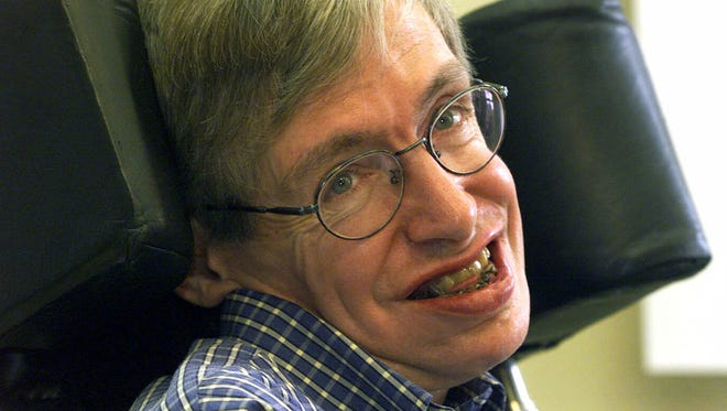In this July 21, 1999 file photo Professor Stephen Hawking smiles during a news conference at the University of Potsdam, near Berlin, Germany. Hawking, whose brilliant mind ranged across time and space though his body was paralyzed by disease, has died, a family spokesman said on March 14, 2018.