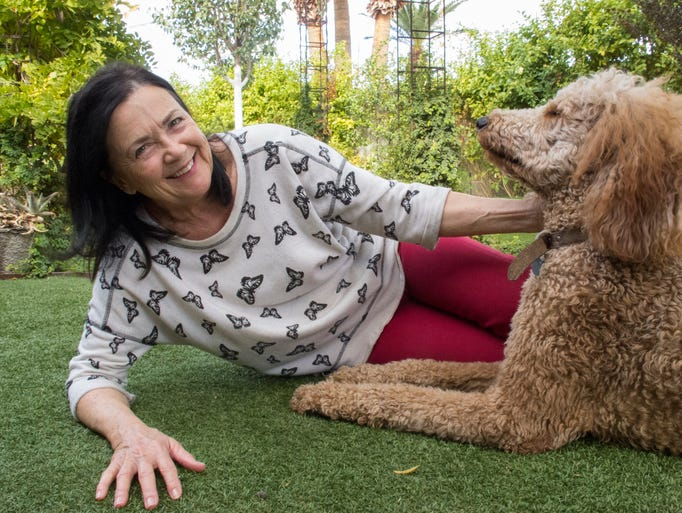 Leslie Cosper and her dog, Degas, play in their Scottsdale