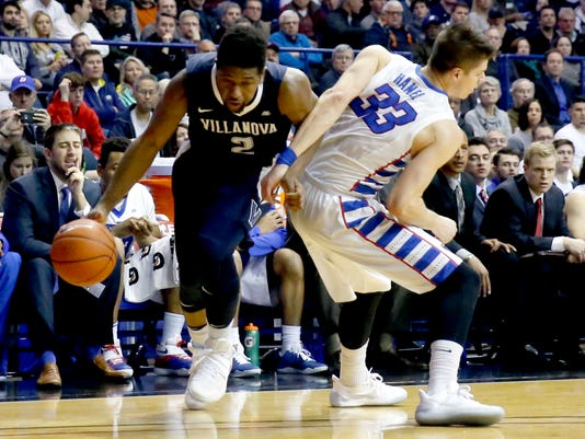 Villanova 's Kris Jenkins (2) is fouled by DePaul 's Joe Hanel as Jenkins drives to the basket during the first half of an NCAA college basketball game, Monday, Feb. 13, 2017, in Rosemont, Ill. (AP Photo/Charles Rex Arbogast)