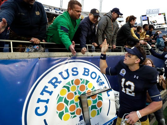 Notre Dame players celebrate after winning the 2017 Citrus Bowl.