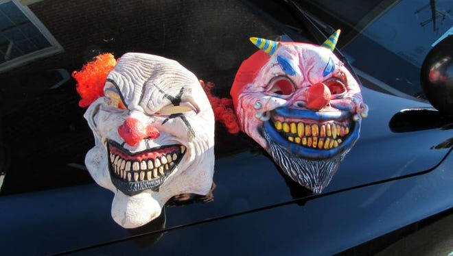 Two of the clown masks worn by teenagers, who police say followed and taunted a female motorist for 20 miles, beginning on Route 23 South in Butler.