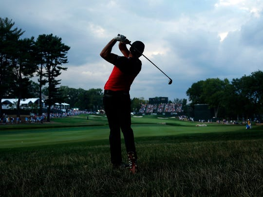 Jason Day hits his approach shot to the 18th hole during the PGA Championship golf tournament at Baltusrol Golf Club in Springfield, N.J.