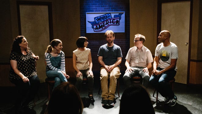"""Tami Sagher, left, Gillian Jacobs, Kate Micucci, Mike Birbiglia, Chris Gethard and Keegan-Michael Key in, """"Don't Think Twice."""""""