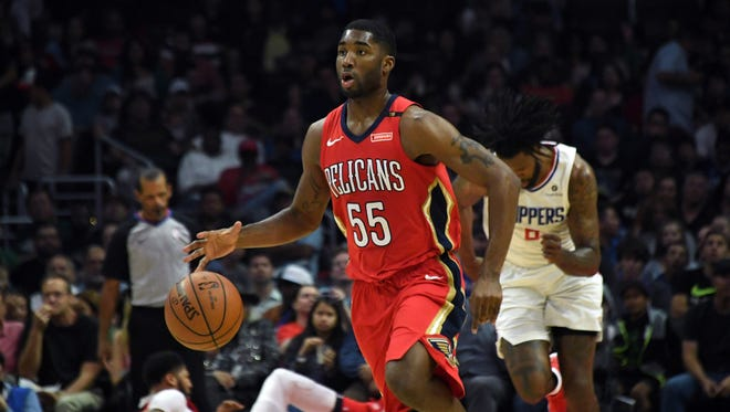 New Orleans Pelicans guard E'Twaun Moore (55) dribbles the ball against the LA Clippers  during an NBA basketball game at Staples Center. The Pelicans defeated the Clippers 113-100.