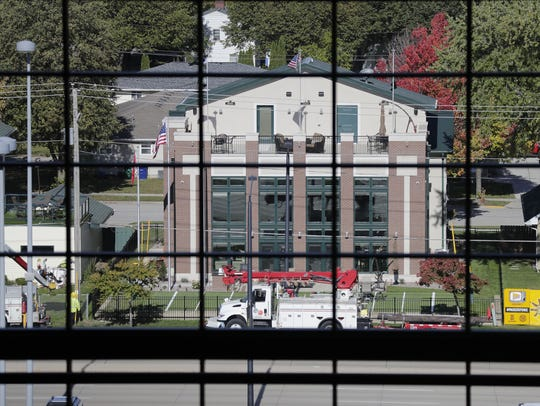 A four-story house at 1225 Shadow Lane, owned by Robert and Patricia Endries of Brillion, viewed through the glass wall of the Lambeau Field Atrium in Green Bay.