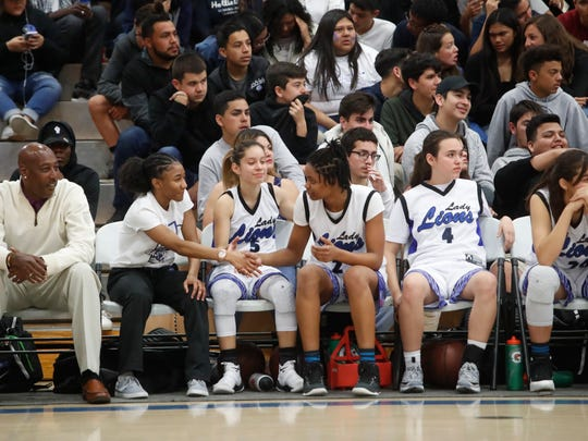 Cathedral City High School players sit with a comfortable lead in the fourth quarter against Olympian High during their round of 16 CIF Southern California Regional game at Cathedral City High School on March 7, 2018. The Lions won 63-39.