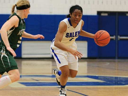 Salem senior guard Jamyra Wilson, active all night in her team's championship win, dribbles up the floor against a Waterford Kettering defender.