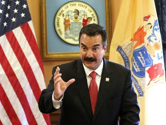 Assembly Speaker Vincent Prieto talks to the press