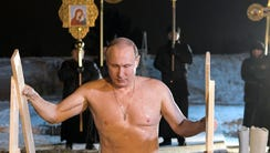 Russian President Vladimir Putin bathes in  ice-cold