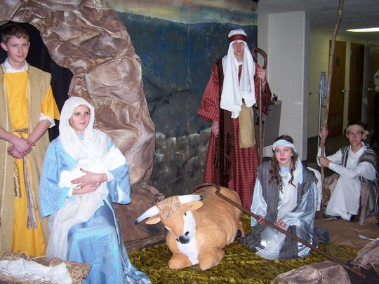 The Church of Jesus Christ of Latter-day Saints, Hollywood Drive, held a concert on Dec. 13, with a live Nativity portrayed by youth groups of the York, Shrewsbury and West York wards and the Dover and Columbia branches. Pictured at the event are, from left, Brian Whitney as Joseph; Madelyn Whitney, as Mary holding the Yorgason infant boy; and shepherds Eric Spahr, Alexis Shoemaker and John Patterson, all of the York ward.