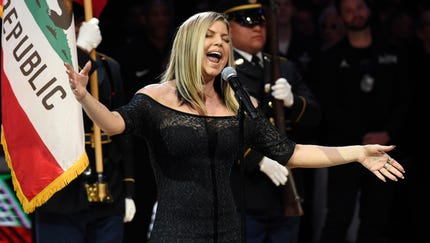 In this Sunday, Feb. 18, 2018, photo, Fergie...