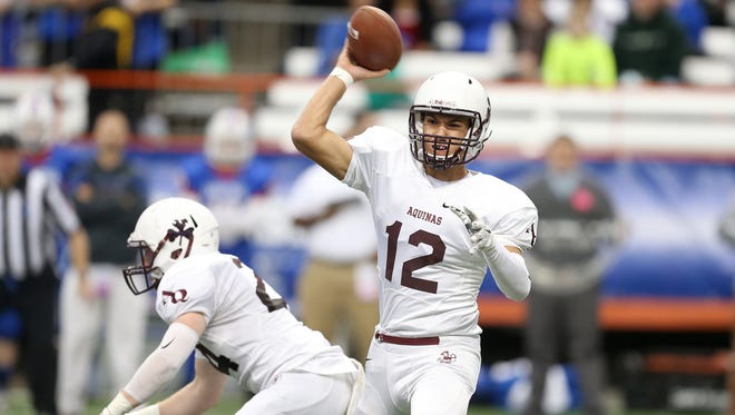 Former Aquinas quarterback Jake Zembiec, who led the Little Irish to the state title last fall and is now enrolled at Penn State, is one of several local athletes who'll be honored at the Rochester Press-Radio Club's annual dinner on May 31.