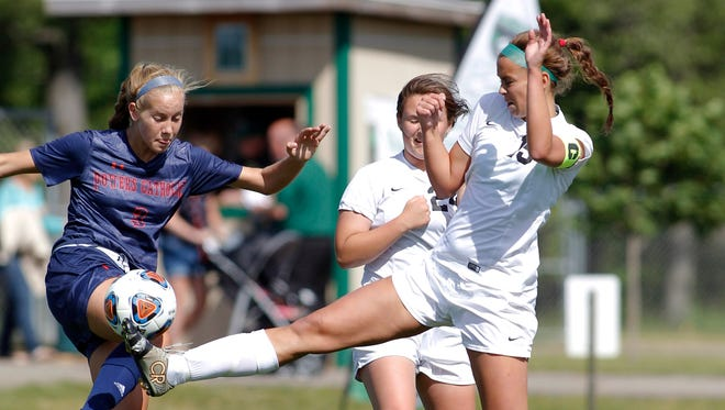 Williamston's Kenzie Seaman, right, and Flint Powers Catholic's Kennedy Myers vie for the ball in their regional game, Tuesday, June 6, 2017, in Williamston. Williamston fell 2-1.