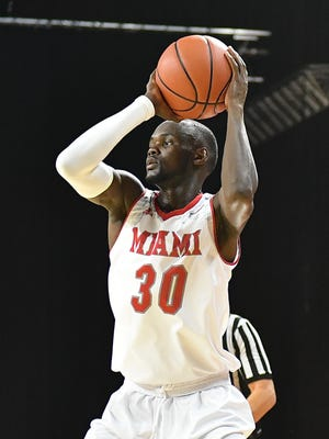 Abdoulaye Harouna drives to the hoop for Miami.